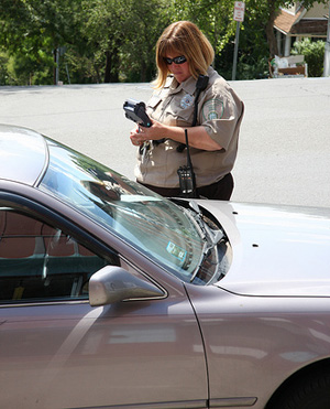 Female cop writing ticket